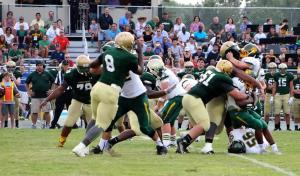 Breyon Gaddy on the tackle, Brandon Gaddy (#8), Brett Lopez (#51), and Devonta Townsend (#78) Photo courtesy of BSCHS.